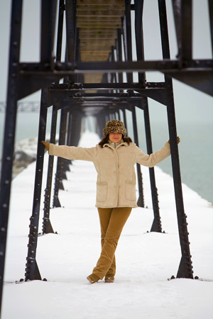 Judy isn't a big fan of the cold, but she is a good sport and has a great sense of adventure.  Here she strikes a pose without me having to ask twice as we explore a lighthouse on Lake Michigan in some chilly weather.