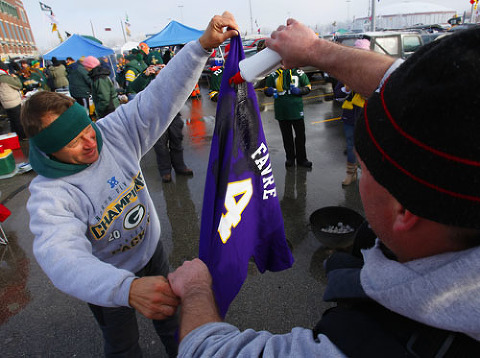 Packers fans pour lighter fluid on a Brett Favre jersey.