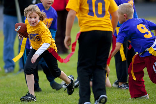 Youth flag football in Green Bay, Wisconsin.  The ball carrier is my niece Izzy.