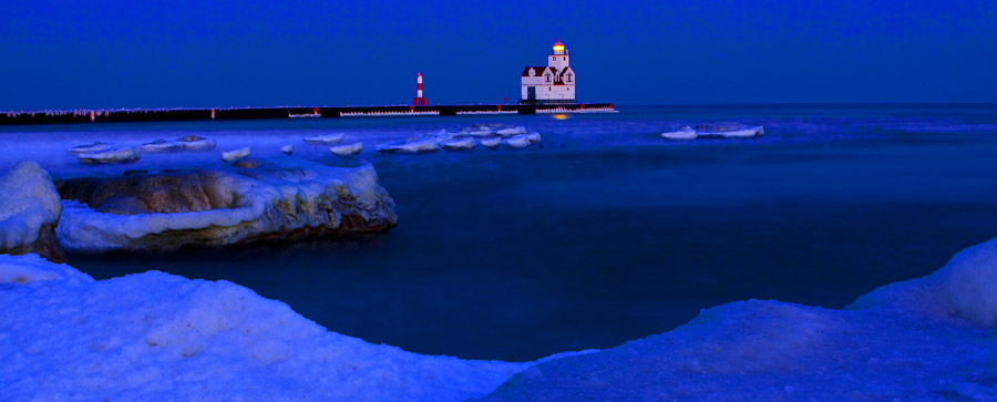 Kewaunee, Wisconsin Lighthouse at just after a winter sunset.