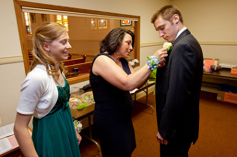 My godson Michael gets pinned with his corsage by Judy's sister Mary.