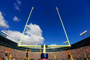 Four F-16s perform a flyover before the Packers Lions game.