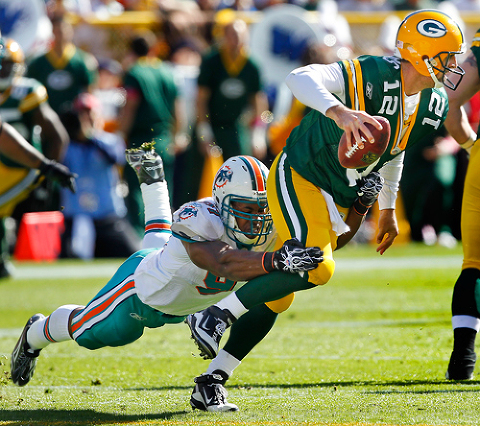 Miami Dolphins linebacker Cameron Wake sacks Green Bay Packers quarterback Aaron Rodgers.