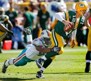 Miami Dolphins linebacker Cameron Wake sacks Green Bay Packers quarterback Aaron Rodgers.