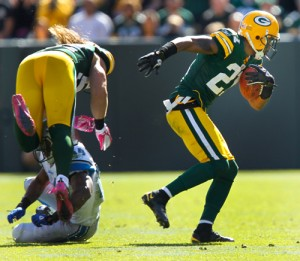 Green Bay Packers cornerback Charles Woodson returns an interception for a touchdown.