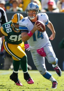 Detroit Lions quarterback Shaun Hill tries to elude the defensive pressure of Green Bay Packers defensive end Mike Neal.