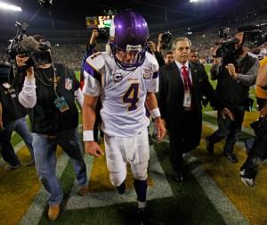 Minnesota Vikings quarterback Brett Favre walks off of Lambeau Field for possibly the last time with his head down.