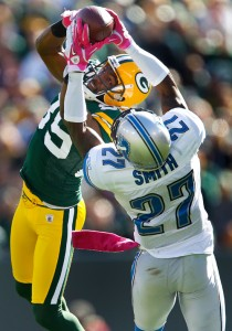 Detroit Lions cornerback Alphonso Smith Green Bay Packers wide receiver Greg Jennings for an interception.