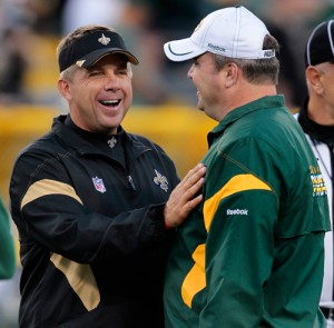 New Orleans Saints head coach Sean Payton and Green Bay Packers head coach Mike McCarthy joke around before the game.