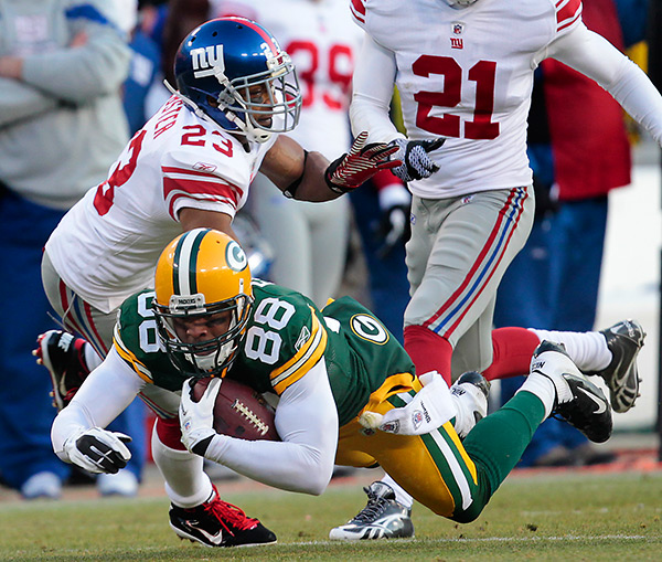 New York Giants cornerback Corey Webster takes down Green Bay Packers tight end Jermichael Finley.