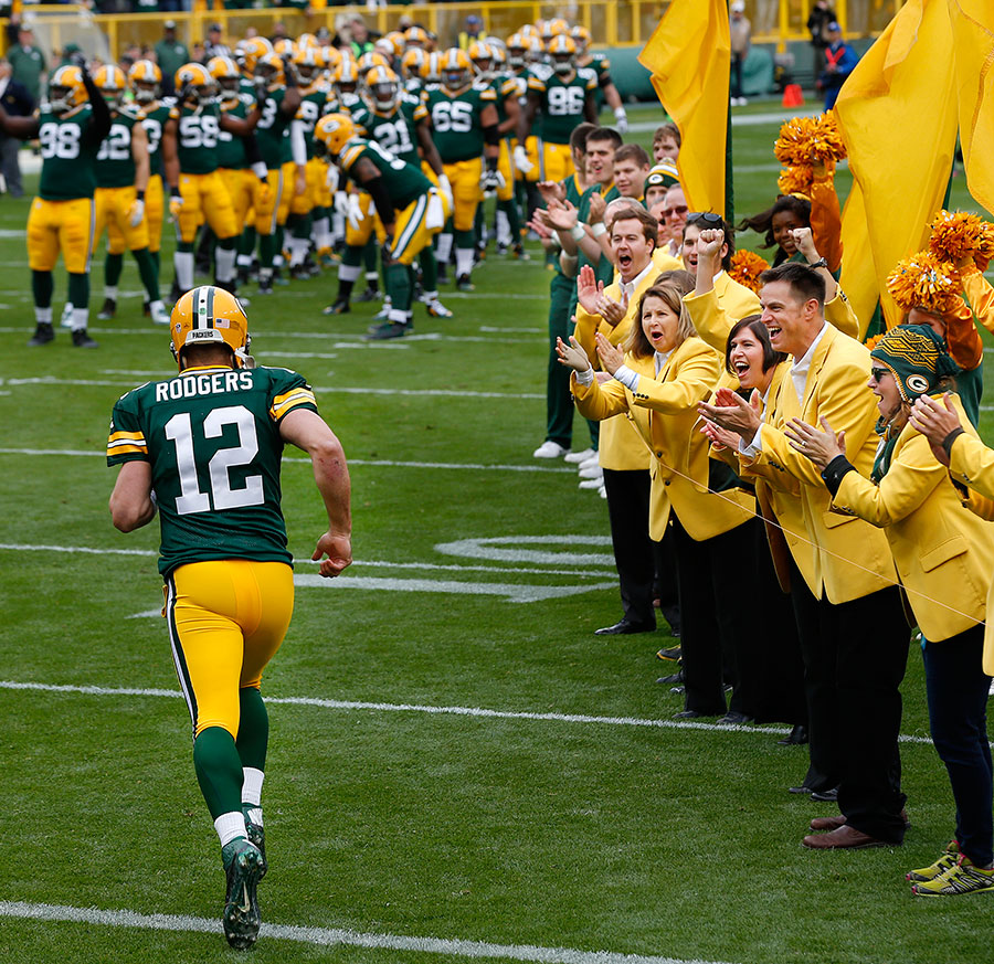 Green Bay Packers quarterback Aaron Rodgers runs on to the field during player introductions.