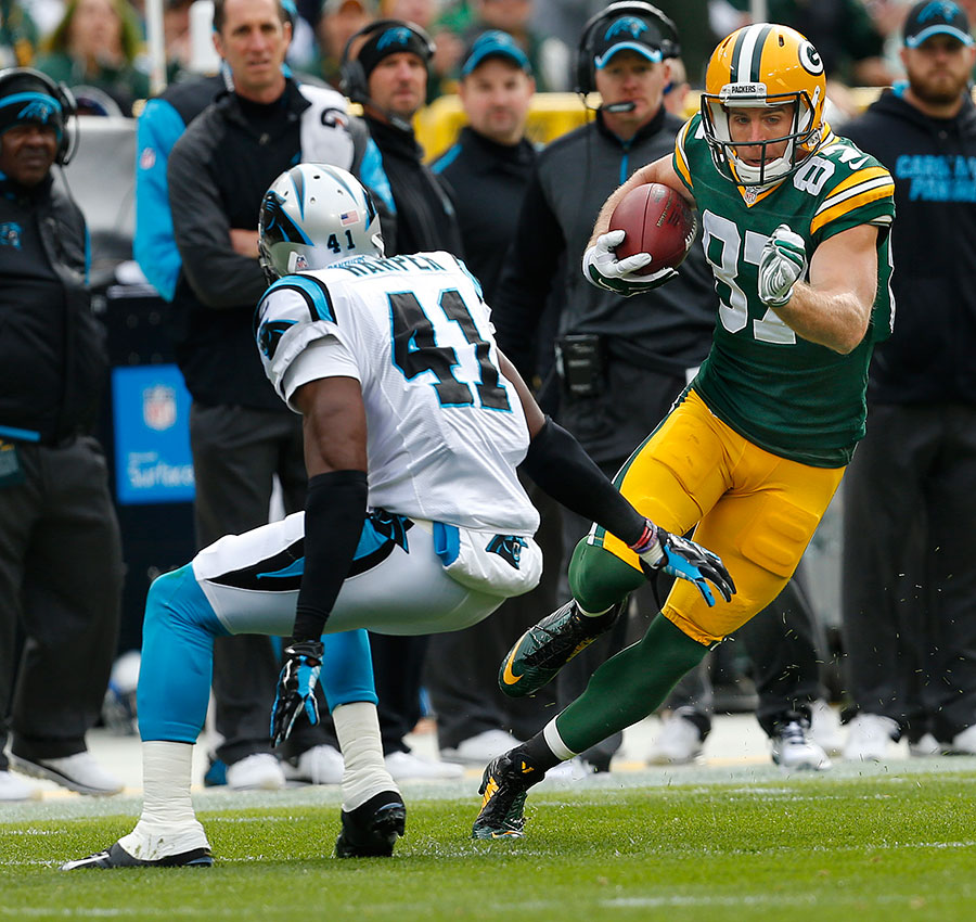Green Bay Packers wide receiver Jordy Nelson gets past Carolina Panthers strong safety Roman Harper on his way to a 59 years catch and run touchdown.
