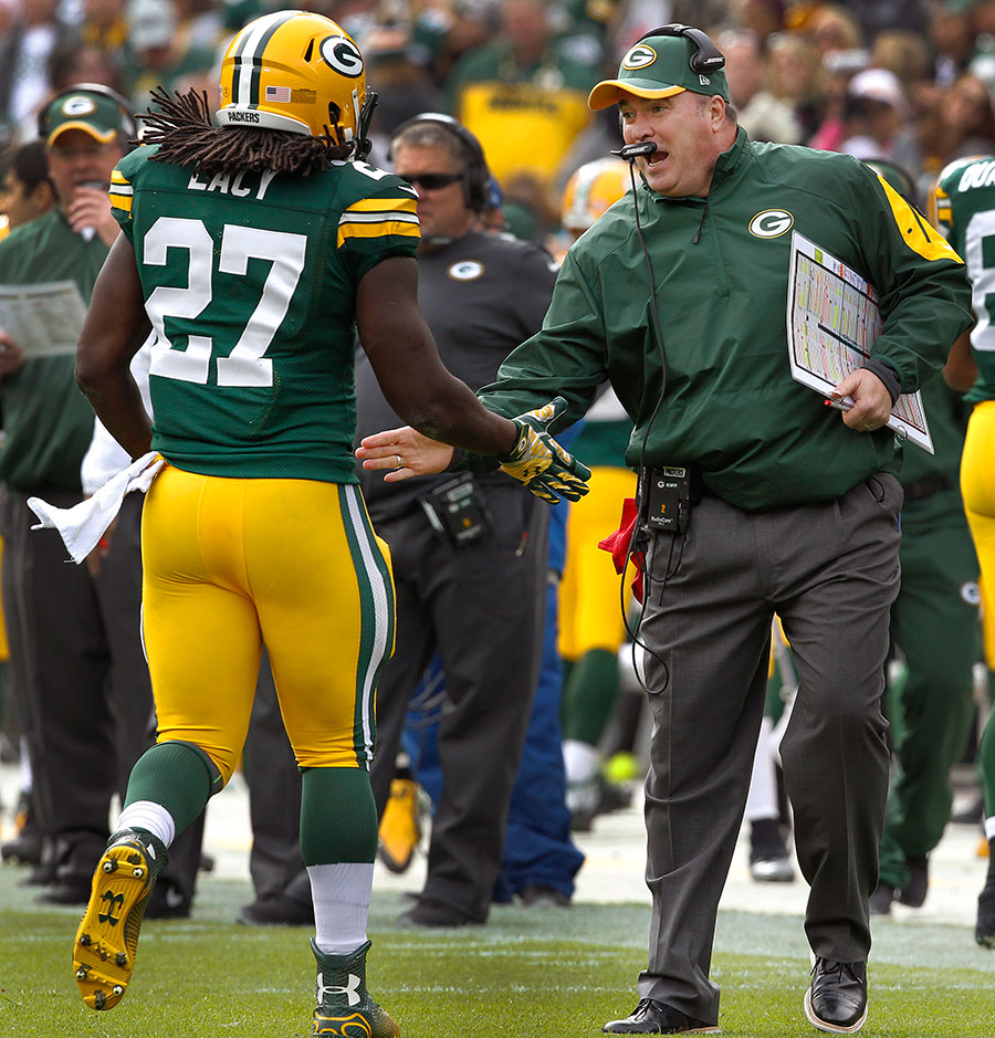 Green Bay Packers head coach Mike McCarthy congratulates Green Bay Packers running back Eddie Lacy on a touchdown run.