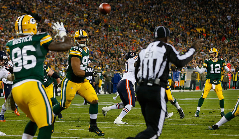 Green Bay Packers quarterback Aaron Rodgers watches a touchdown pass sail to tight end Brandon Bostick.