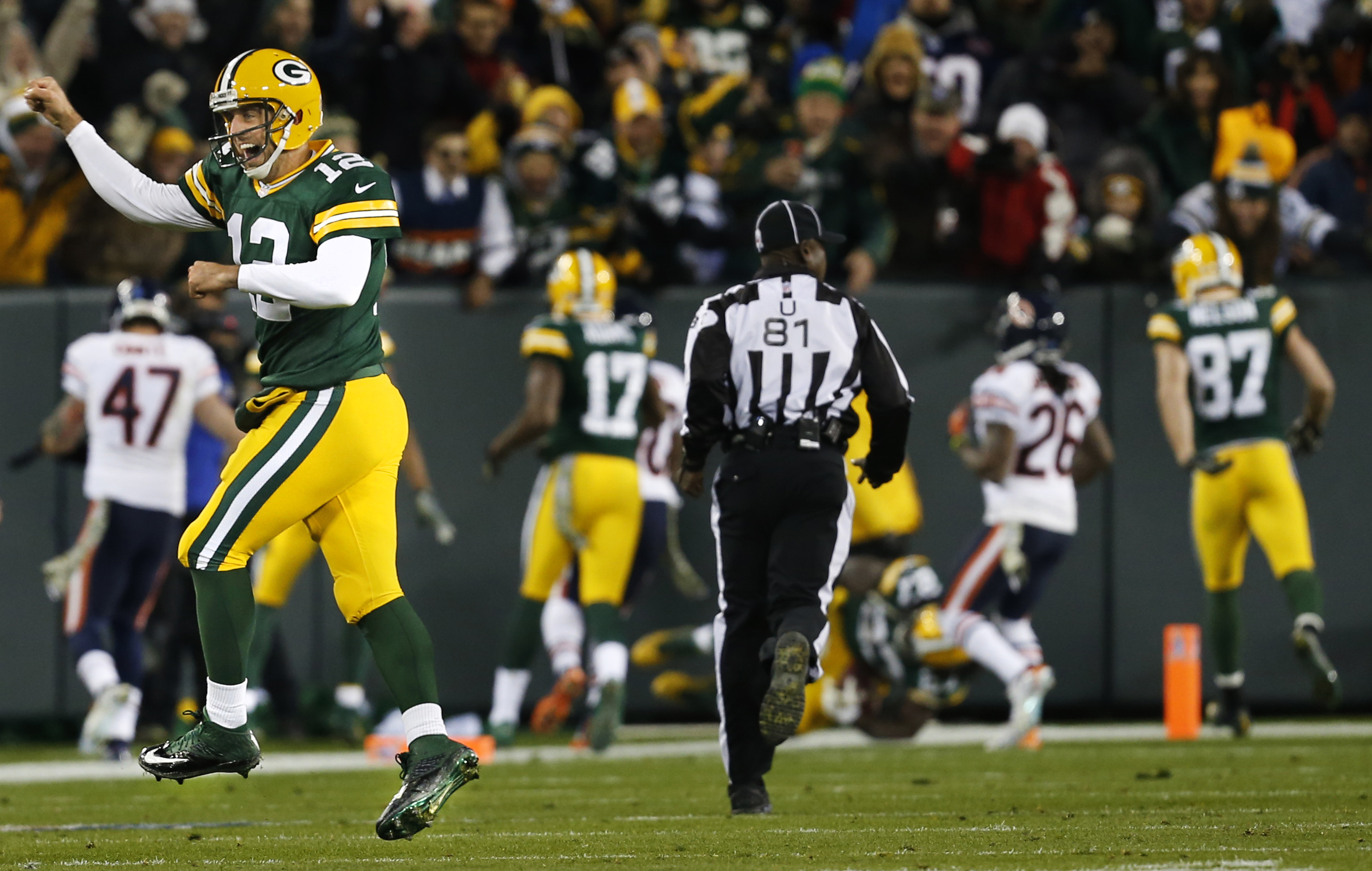 Green Bay Packers quarterback Aaron Rodgers celebrates a touchdown pass to wide receiver Randall Cobb.
