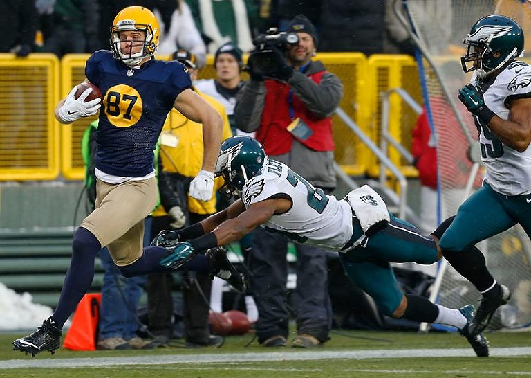 Philadelphia Eagles cornerback Bradley Fletcher tries to stop Green Bay Packers wide receiver Jordy Nelson.
