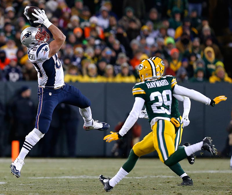 New England Patriots tight end Rob Gronkowski pulls in a pass for a first down.