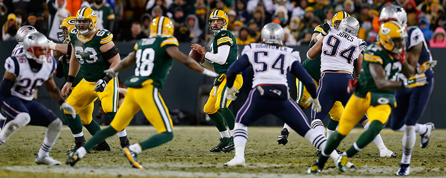 Green Bay Packers quarterback Aaron Rodgers looks for receiver.