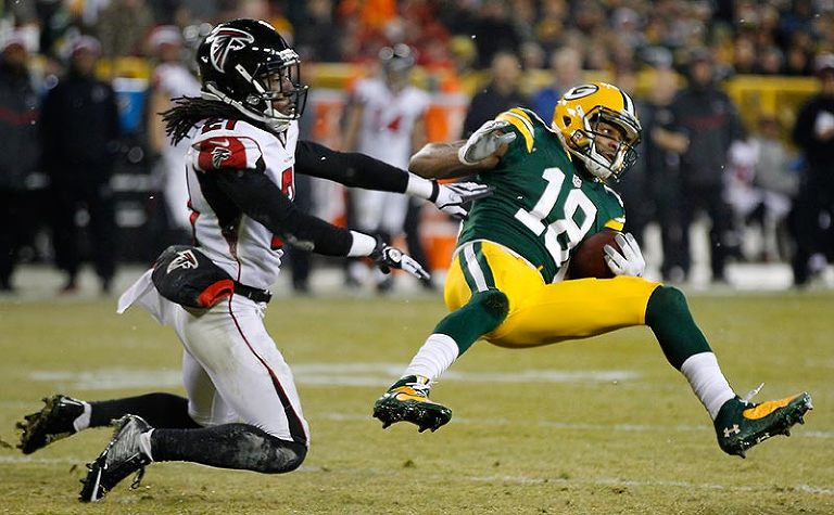 Green Bay Packers wide receiver Randall Cobb catches a pass for a first down as Atlanta Falcons cornerback Desmond Trufant defends.