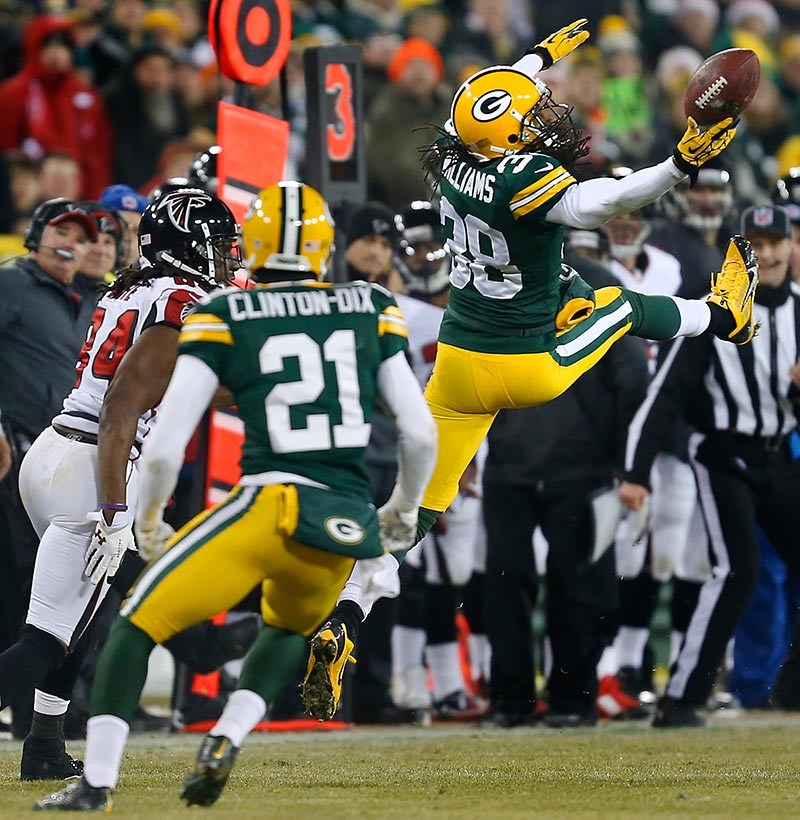 Green Bay Packers cornerback Tramon Williams bats away a pass intended for Atlanta Falcons wide receiver Roddy White.