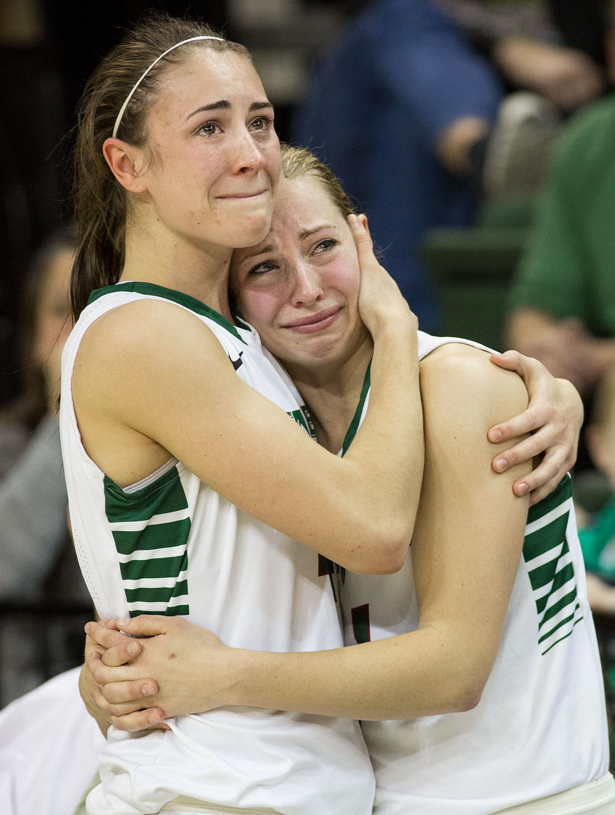 Megan Lukan hugs her younger sister Kaili.