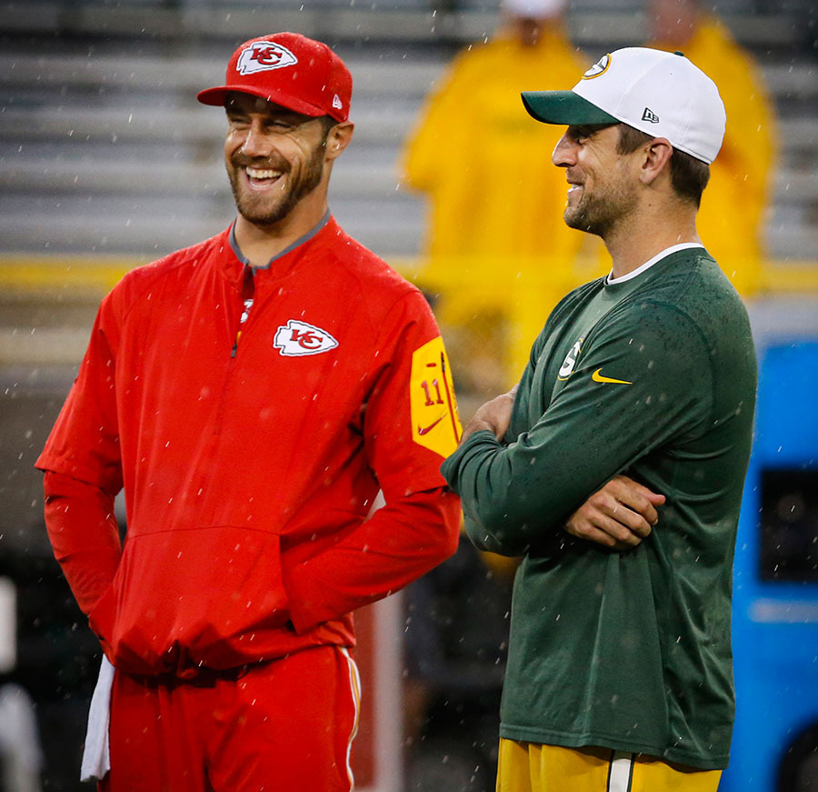 Kansas City Chiefs quarterback Alex Smith and Green Bay Packers quarterback Aaron Rodgers share a laugh prior to the game.