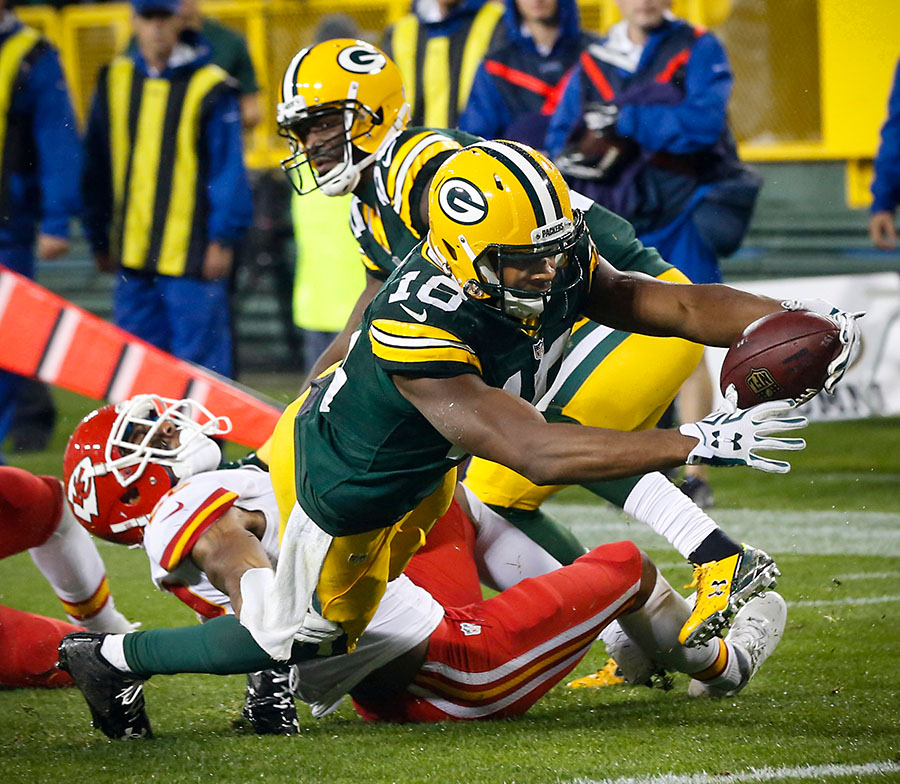 Green Bay Packers wide receiver Randall Cobb scores one of his three touchdowns.