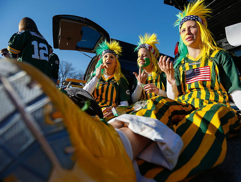 Packers fans Dorothy Konkol, Mell Whitehouse and Trisha Buisse paint their faces while tailgating.