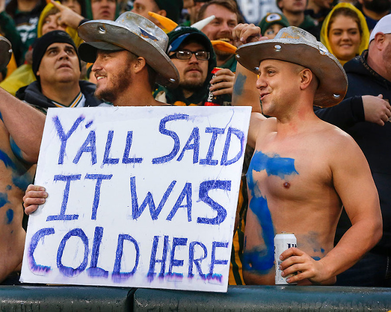 Dallas Cowboys fans enjoy the warmest game every played at Lambeau Field in December.