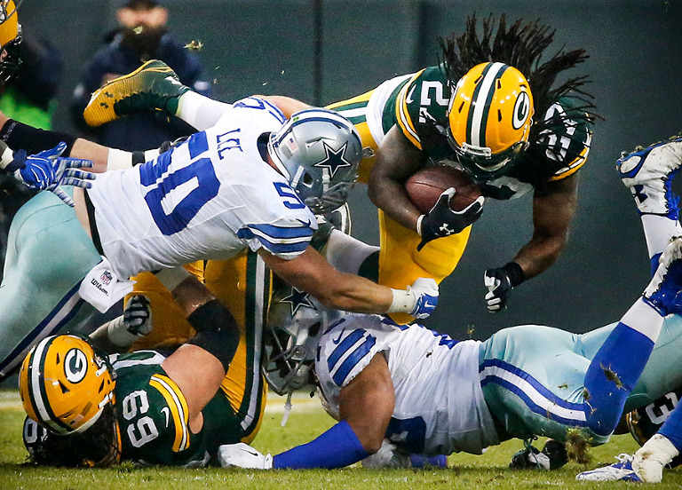 Green Bay Packers running back Eddie Lacy gets some of his 124 years against the Dallas Cowboys.
