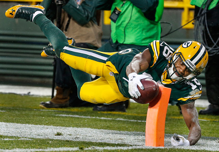 Green Bay Packers wide receiver Randall Cobb can't stay inbounds as he tries to score a touchdown.