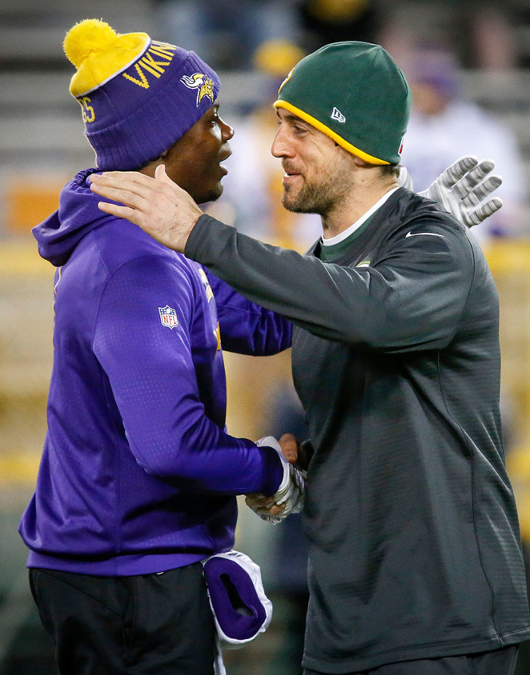 Minnesota Vikings quarterback Teddy Bridgewater greets Green Bay Packers quarterback Aaron Rodgers before the game.