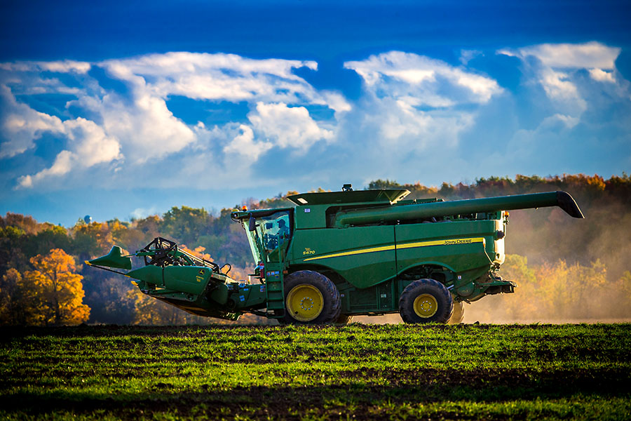 A combine heads out to take on a days work near Chilton, Wisconsin.