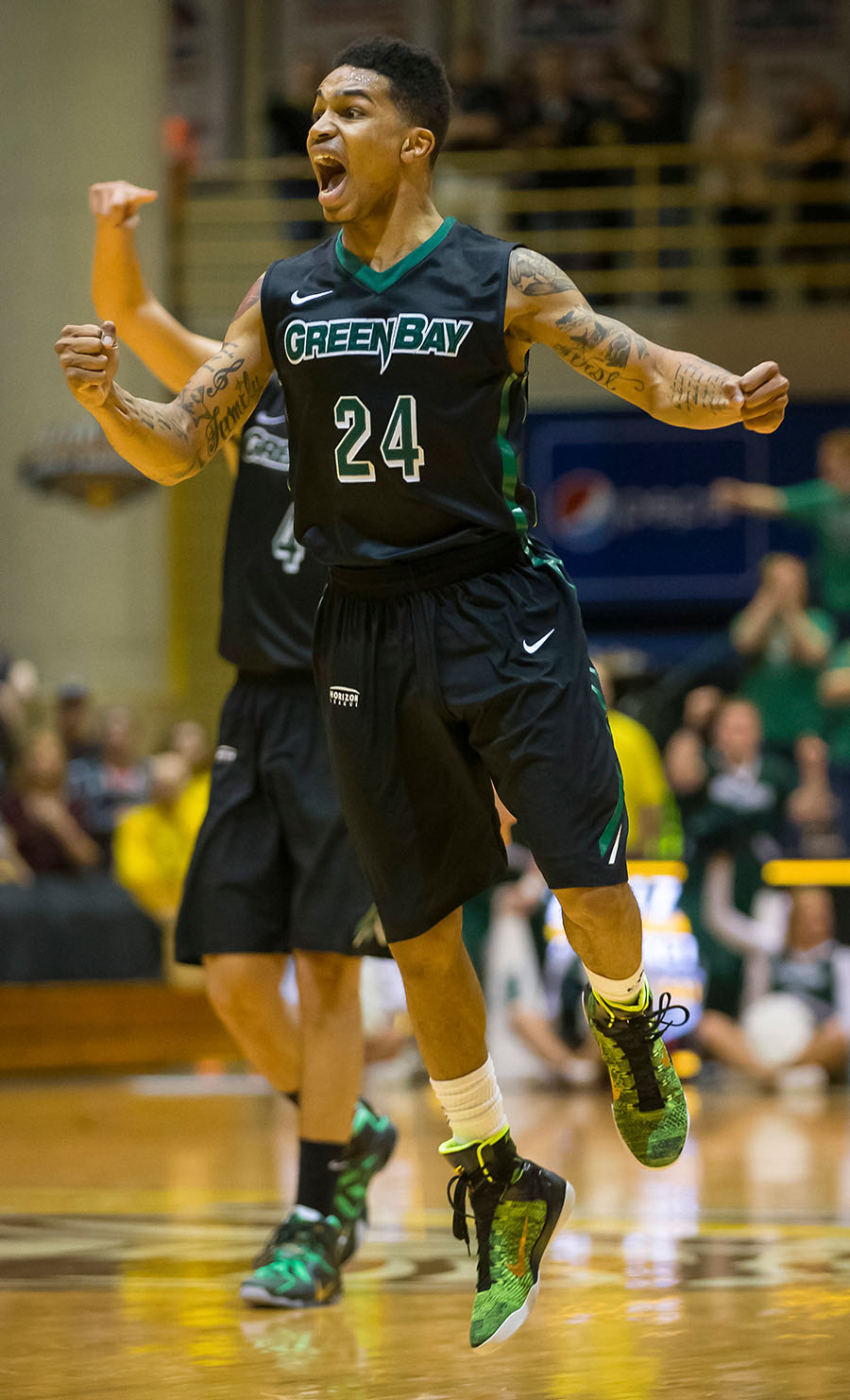 Green Bay men's basketball player Kiefer Sykes celebrates a basket during the Horizon League Championship. The Phoenix would go on to lose the game