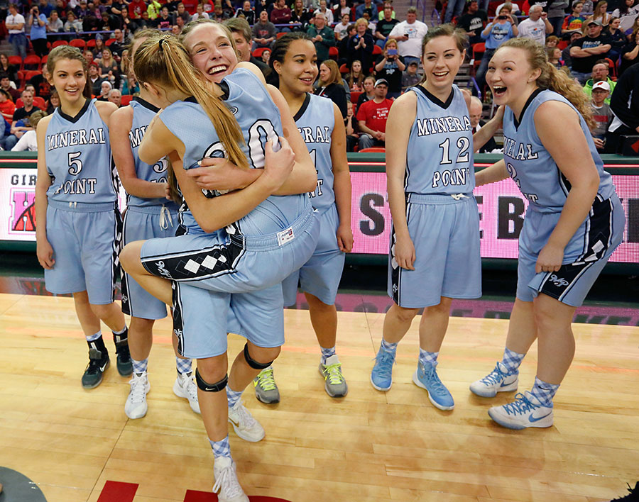 Mineral Point's Sydney Staver lifts up a hugs Clara Chamber after defeating Kenosha St. Joseph's 68-52 in the Division 4 finals.