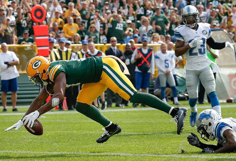 Green Bay Packers wide receiver Davante Adams scores a first half touchdown.