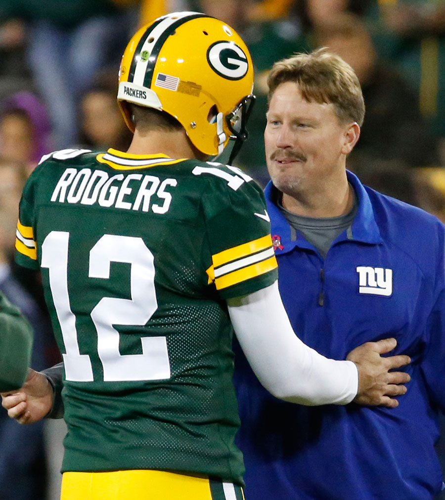Green Bay Packers quarterback Aaron Rodgers and New York Giants head coach Ben McAdoo talk before the game.