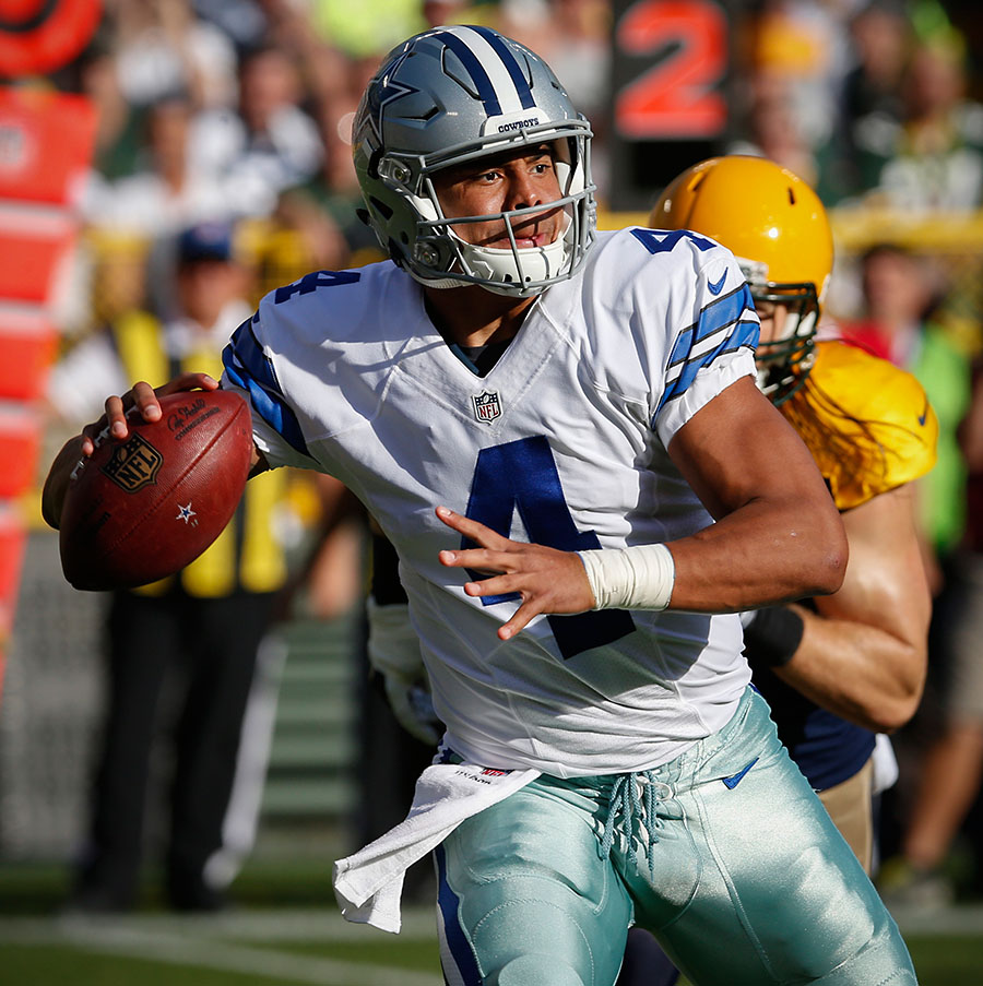 Dallas Cowboys quarterback Dak Prescott looks for a receiver.