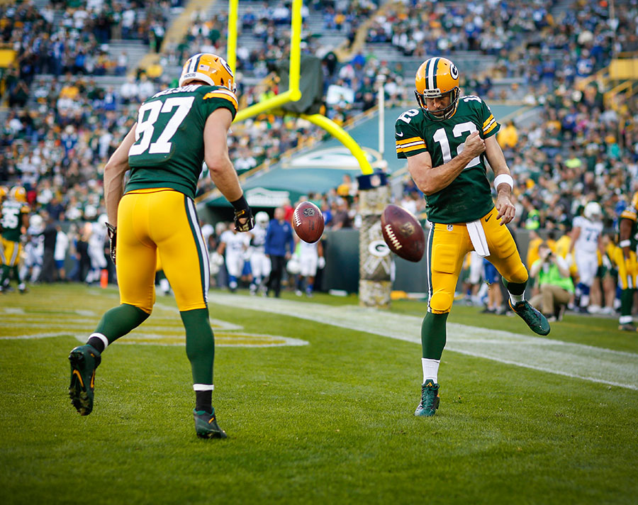 I've shot this photo a number of times, but I think this is my favorite one. Green Bay Packers quarterback Aaron Rodgers and wide receiver Jordy Nelson spin a ball in the end zone after warm ups.