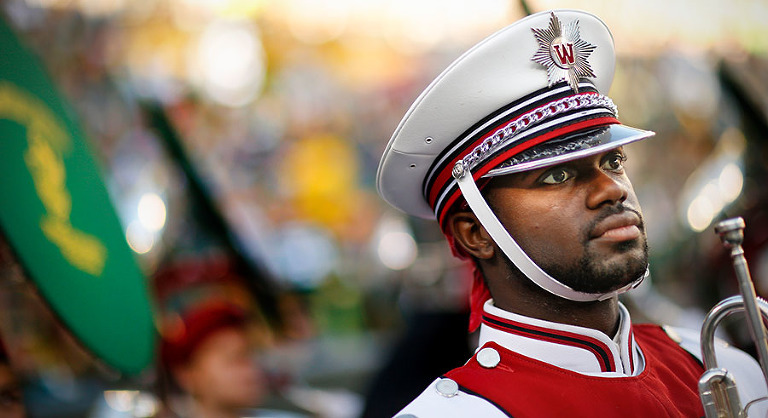 A member of the University Wisconsin marching band before a pregame performance.
