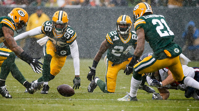 Green Bay Packers safety Morgan Burnett recovers a fumble.