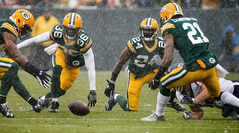 Green Bay Packers safety Morgan Burnett recovers a fumble.