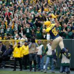 Green Bay Packers tight end Jimmy Graham celebrates after scoring a touchdown.