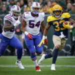 Green Bay Packers running back Aaron Jones runs for a first down.