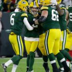 Green Bay Packers kicker Mason Crosby celebrates his game wining field goal.