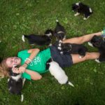 Izzy Kellner plays with puppies in St Anne, Wisconsin.